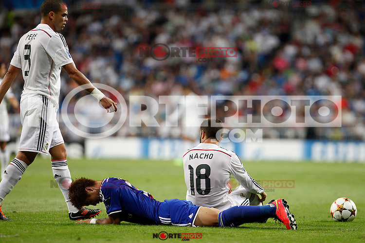 Pepe and Nacho of Real Madrid and Yoichiro Kakitani of FC Basel 1893 during the Champions League group B soccer match between Real Madrid and FC Basel 1893 at Santiago Bernabeu Stadium in Madrid, Spain. September 16, 2014. (ALTERPHOTOS/Caro Marin) /NortePhoto.com