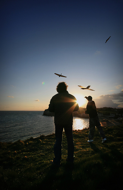 Flying model planes on the cliffs above freshwater bay, isle of wight