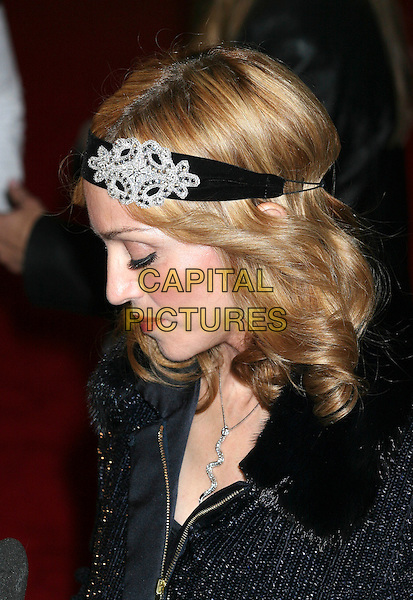 "MADONNA.Premiere ""I'm Going To Tell You A Secret"" at the Loews Lincoln Center, New York City..STUART PRICE.October 18th, 2005.Ref: IW.headhsot portrait black diamond brooch clasp alice band headband head band profile eyes closed.www.capitalpictures.com.sales@capitalpictures.com.©Capital Pictures"