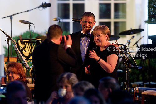 """United States President Barack Obama and Angela Merkel, Germany's chancellor, have their photo taken during a State Dinner on the South Lawn at the White House in Washington, D.C., U.S., on Tuesday, June 7, 2011. Obama said he and Merkel agreed that the debt crisis in Europe """"cannot be allowed to put the global economic recovery at risk."""" .Credit: Andrew Harrer / Pool via CNP"""