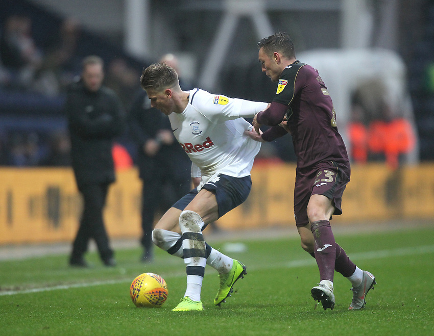 Preston North End's Brad Potts battles with  Swansea City's Connor Roberts<br /> <br /> Photographer Mick Walker/CameraSport<br /> <br /> The EFL Sky Bet Championship - Preston North End v Swansea City - Saturday 12th January 2019 - Deepdale Stadium - Preston<br /> <br /> World Copyright © 2019 CameraSport. All rights reserved. 43 Linden Ave. Countesthorpe. Leicester. England. LE8 5PG - Tel: +44 (0) 116 277 4147 - admin@camerasport.com - www.camerasport.com