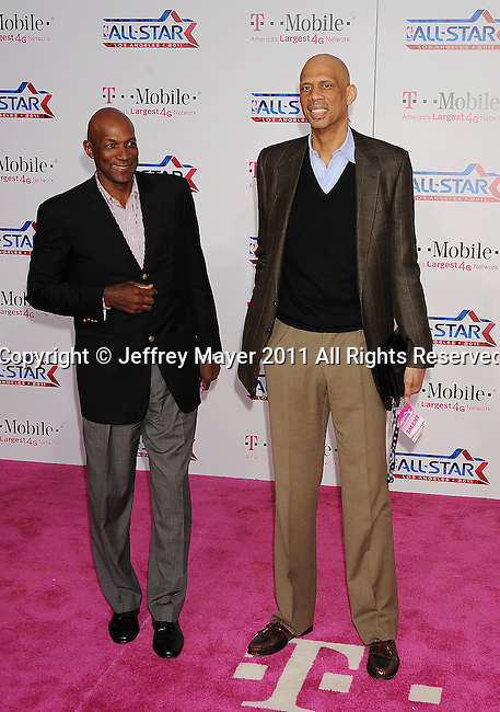 LOS ANGELES, CA - FEBRUARY 20: Clyde Drexler and Kareem Abdul Jabbar arrive at the T-Mobile Magenta Carpet at the 2011 NBA All-Star Game at L.A. Live on February 20, 2011 in Los Angeles, California.