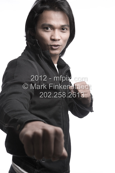"Slug: WK/JAA.Date: 08-18-2006.Photographer: Mark Finkenstaedt FTWP.Location; The Ritz Carlton. Georgetown. Washington, DC.Caption: Tony Jaa Thai Martial Arts Movie Star promotes "" The Protector""....© 2006 Mark Finkenstaedt. All Rights Reserved. Usual Post terms. LATimes WP News Service OUT unless under special arrangement with the photographer. No thrid party sales, loans or trades. Contacts; 703-237-8887 .  mark@mfpix.com"