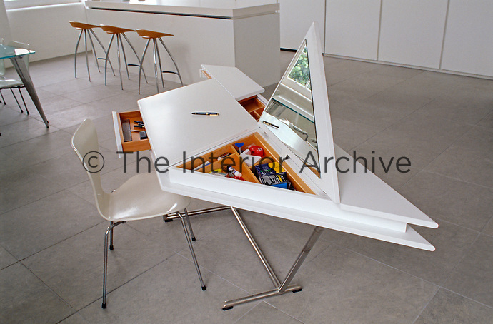 Detail of an ingenious desk with a variety of unexpected storage areas