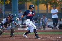 AZL Indians Red Yordys Valdes (10) at bat in front of catcher Chandler Seagle (11) during an Arizona League game against the AZL Padres 1 on June 23, 2019 at the Cleveland Indians Training Complex in Goodyear, Arizona. AZL Indians Red defeated the AZL Padres 1 3-2. (Zachary Lucy/Four Seam Images)