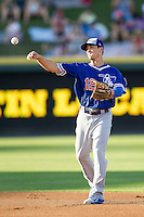 Oklahoma City Dodgers second baseman Darwin Barney (12) makes a throw to first base during the Pacific Coast League baseball game against the Round Rock Express on June 9, 2015 at the Dell Diamond in Round Rock, Texas. The Dodgers defeated the Express 6-3. (Andrew Woolley/Four Seam Images)