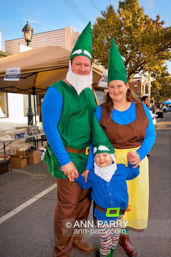 Garden Gnomes family, a father, mother and young son dressed in costumes garden gnomes at Merrick Street Fair in Merrick, New York, USA, on October 23, 2011