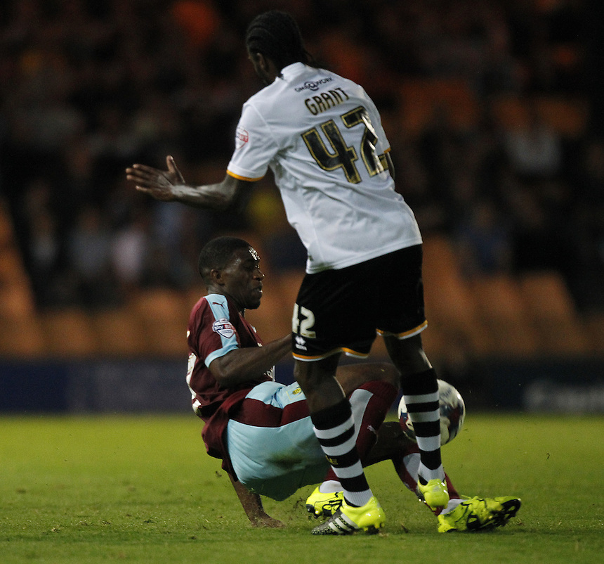Burnley's Tendayi Darikwa tackles Port Vale's Anthony Grant<br />
