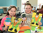 Jade Murphy and Joy Mooney at the St. Patrick's day art workshop in the library. Photo:Colin Bell/pressphotos.ie