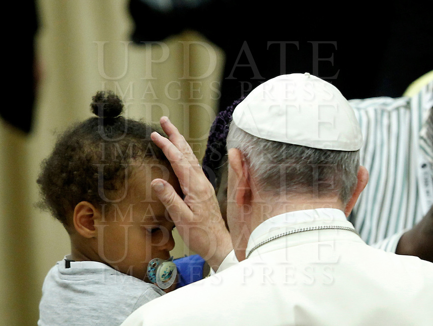 Papa Francesco tiene un'udienza ai familiari delle vittime dell'attacco terroristico di Nizza, in Aula Paolo VI, Citta' del Vaticano, 24 settembre 2016.<br /> Pope Francis attends an audience with relatives of the terrorist attack victims in Nice at the Paul VI hall in Vatican City, 24 September 2016.<br /> UPDATE IMAGES PRESS/Riccardo De Luca<br /> <br /> STRICTLY ONLY FOR EDITORIAL USE
