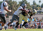 Palos Verdes, CA 09/16/16 - Tony Dacosta (Torrance #63), Robert Gutierrez (Torrance #8) and Jeffrey Jimena (Peninsula #6) in action during the Torrance - Palos Verdes Peninsula CIF Varsity football game.