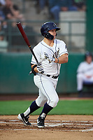 Tri-City Dust Devils Logan Driscoll (19) follows through on his swing during a Northwest League game against the Vancouver Canadians at Gesa Stadium on August 21, 2019 in Pasco, Washington. Vancouver defeated Tri-City 1-0. (Zachary Lucy/Four Seam Images)
