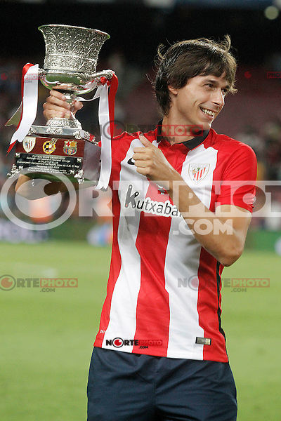 Athletic de Bilbao's Ander Iturraspe celebrates the victory in the Supercup of Spain. August 17,2015. (ALTERPHOTOS/Acero)
