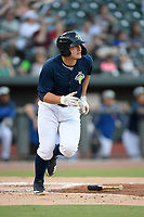 Designated hitter Hayden Senger (15) of the Columbia Fireflies runs out a batted ball in a game against the Lexington Legends on Friday, May 3, 2019, at Segra Park in Columbia, South Carolina. Lexington won, 5-2. (Tom Priddy/Four Seam Images)