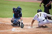 Tampa Tarpons catcher Jason Lopez (10) swipes the tag - though the ball had gotten away - as Deon Stafford (37) scores a run during a Florida State League game against the Bradenton Marauders on May 26, 2019 at LECOM Park in Bradenton, Florida.  Bradenton defeated Tampa 3-1.  (Mike Janes/Four Seam Images)