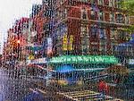 Abstract image of a New York street corner through a rain-streaked window
