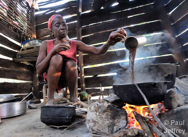Chabine Phitrion cooks over a fire in the Haitian village of Belande.