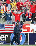 29 January 2006: Freddy Adu (front) and Eddie Johnson, of the U.S., walk to the bench, passing in front of the U.S. supporter's section. The United States Men's National Team defeated their counterparts from Norway 5-0 at the Home Depot Center in Carson, California in a men's international friendly soccer game.