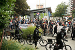 Protestors make their way down Denny Street during the Solidarity Against Hate rally Sunday August 13, 2017 in Seattle.
