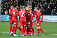 O's Josh Wright celebrates with team mats after scoring penalty during Cambridge United vs Leyton Orient, Sky Bet EFL League 2 Football at Abbey Stadium on 21st December 2019
