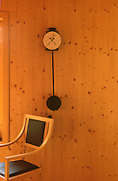 An Odo pendulum clock designed by Armando Baldini hangs on the wall of the dining area