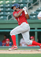Outfielder Domingo Santana (13) of the Lakewood BlueClaws, Class A affiliate of the Philadelphia Phillies, in a game against the Greenville Drive on July 12, 2011, at Fluor Field at the West End in Greenville, South Carolina. (Tom Priddy/Four Seam Images)
