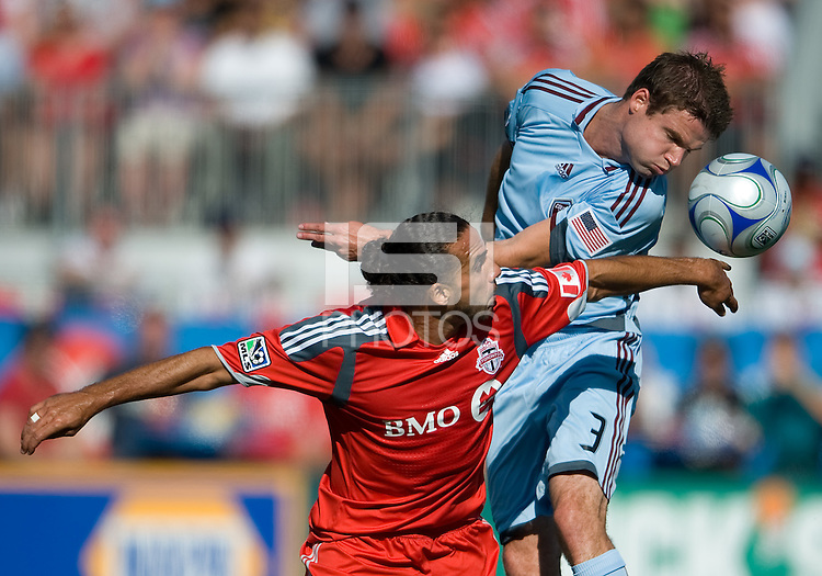 12 September 2009: Colorado Rapids defender Drew Moor #3 and Toronto FC midfielder Dewayne DeRosario #14 battle for a ball during MLS action at BMO Field Toronto in a game between Colorado Rapids and Toronto FC. .Toronto FC won 3-2..
