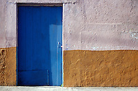 Blue door of a house in the town of San Miguel de Cozumel, Isla de Cozumel, Quintana Roo, Mexico