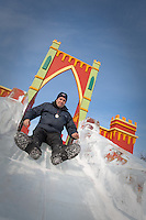 Dominick Miserandino rides an ice slide at the Quebec Winter Carnival (Carnaval de Quebec) in Quebec city, February 3, 2010. With close to one million participants, it has grown to become the third largest winter celebration in the world.