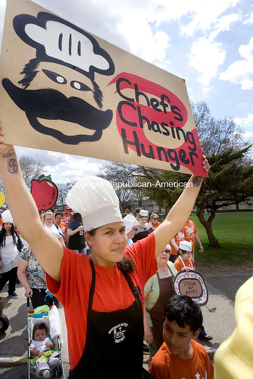 WATREBURY CT. 03 May 2015-050315SV06-Eleuteria Inman of Waterbury carries a sign while marching for hunger during the Walk for Hunger in Waterbury Sunday. The Connecticut Food Bank&rsquo;s Walk Against Hunger joined together local partner programs and anti-hunger advocates making a difference in the lives of so many people facing hunger.<br /> Steven Valenti Republican-American
