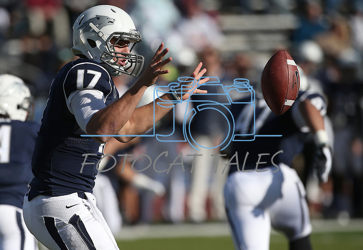 Nevada's Cody Fajardo (17) pitches the ball to a running back during the first half an NCAA college football game against BYU in Reno, Nev., on Saturday, Nov. 30, 2013. (AP Photo/Cathleen Allison)