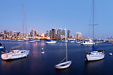 USA, California, San Diego, a few sailboats moored in the San Diego Bay waterfront at dusk