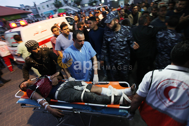 A Palestinian wounded lies on stretcher after he was shot by Israeli security forces during clashes at the Israel-Gaza borde during a tent city protest demanding the right to return to their homeland, at al-Shifa hospital in Gaza city on April 6, 2018. Photo by Mahmoud Ajour