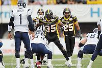 September 6, 2010; Hamilton, ON, CAN; Hamilton Tiger-Cats linebacker Otis Floyd (35) and linebacker Markeith Knowlton (25). CFL football: Labour Day Classic - Toronto Argonauts vs. Hamilton Tiger-Cats at Ivor Wynne Stadium. The Tiger-Cats defeated the Argonauts 28-13. Mandatory Credit: Ron Scheffler.