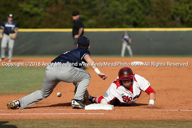 CARY, NC - FEBRUARY 23: Saint John's Ryan Hogan (right) beats a pickoff attempt by Monmouth's Johnny Zega (left). The Monmouth University Hawks played the Saint John's University Red Storm on February 23, 2018 on Field 2 at the USA Baseball National Training Complex in Cary, NC in a Division I College Baseball game. St John's won the game 3-0.