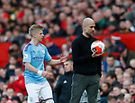 Josep Guardiola manager of Manchester City recovers the ball for Oleksandr Zinchenko of Manchester City during the Premier League match at Old Trafford, Manchester. Picture date: 8th March 2020. Picture credit should read: Darren Staples/Sportimage