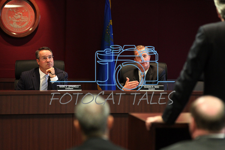 Gaming Control Board Chairman Mark Lipparelli, left, and member Shawn Reid work in a meeting in Carson City, Nev., on Wednesday, Dec. 7, 2011. .Photo by Cathleen Allison
