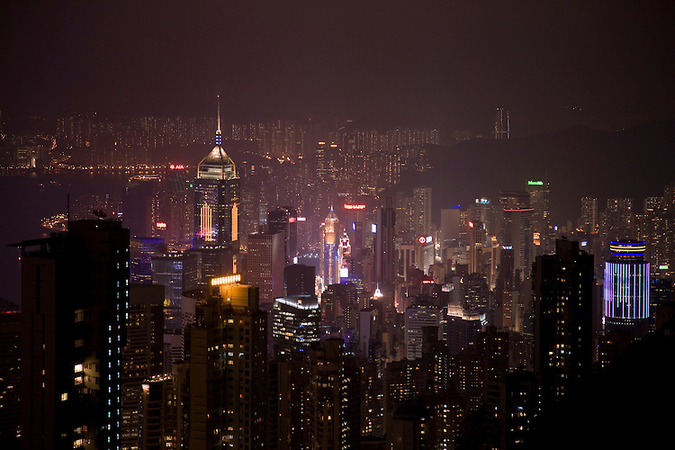 Illuminations of Hong Kong Island famous skyline at night from The Peak, China