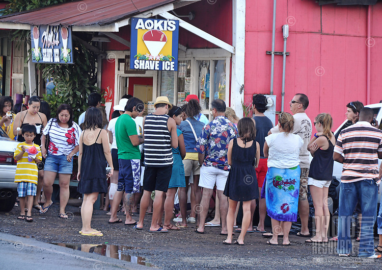 Locals and visitors line up to buy refreshing shave ice at a popular store in Haleiwa on O'ahu's North Shore.