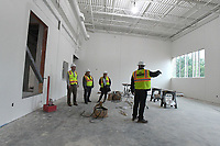 NWA Democrat-Gazette/J.T. WAMPLER Northwest Arkansas Community College trustees Lucas Pointer (FROM LEFT) and Rachel Harris get a tour of the new Integrated Design Lab building under construction on the Bentonville campus from project manager Dena Stone and director of construction for Nabholz Jim Lay. The Integrated design lab is being built just west of the Student Center in Bentonville.