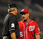 22 August 2009: Washington Nationals' Manager Jim Riggleman discusses a called strike with home plate umpire Mike Reilly during a game against the Milwaukee Brewers at Nationals Park in Washington, DC. Riggleman was ejected by Reilly as the Nationals fell to the Brewers 11-9 in the second game of their four-game series. Mandatory Credit: Ed Wolfstein Photo