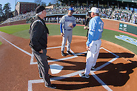 Kentucky Wildcats head coach Nick Mingione (27) exchanges lineup cards with North Carolina Tar Heels head coach Mike Fox (30) and the umpires prior to the game at Boshmer Stadium on February 17, 2017 in Chapel Hill, North Carolina.  The Tar Heels defeated the Wildcats 3-1.  (Brian Westerholt/Four Seam Images)