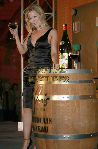 JENNIE GARTH.Jennie Garth and Derek Hough delivered a cask of Beaujolais Nouveau at the base of the Eiffel Tower launching a weeklong Beaujolais Nouveau celebration at Paris Las Vegas, Las Vegas, Nevada, USA..November 14th, 2007.full length black dress wine glass drink jenny barrell .ADM/MJT.©MJT/AdMedia/Capital Pictures.