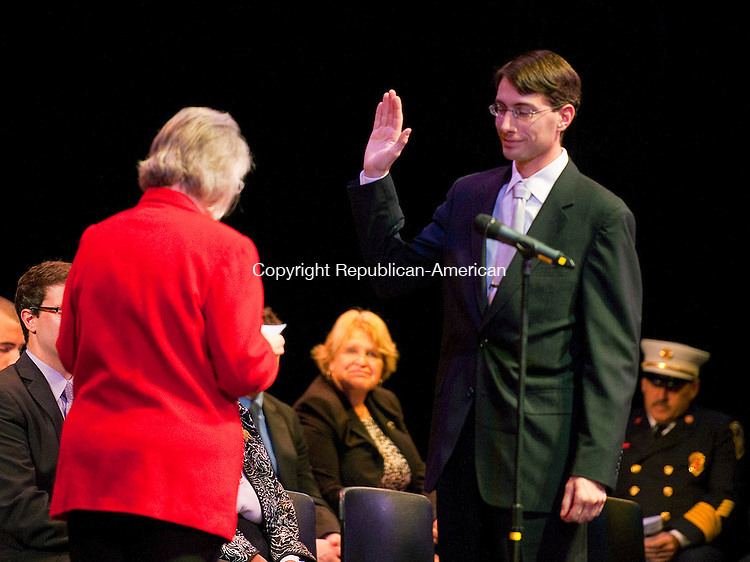 TORRINGTON, CT 120213JS13-City Council member Christopher R. Anderson is sworn in by his mother, Assistant City Clerk Carol Anderson during an inaugural ceremony Monday at the Warner Theatre in Torrington. <br />  Jim Shannon Republican-American