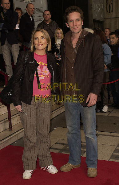 "LISA ROGERS & GUEST.Outside arrivals for ""Movin' Out"" Opening Night, .Apollo Victoria Theatre, London, England, .April 10th 2006..full length brown trousers trainers pink t-shirt.Ref: CAN.www.capitalpictures.com.sales@capitalpictures.com.©Can Nguyen/Capital Pictures"