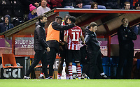 Lincoln City's Bruno Andrade speaks to Lincoln City's Bernard Mensah, left, and Lincoln City's John Akinde after being substituted<br /> <br /> Photographer Chris Vaughan/CameraSport<br /> <br /> Emirates FA Cup First Round - Lincoln City v Northampton Town - Saturday 10th November 2018 - Sincil Bank - Lincoln<br />  <br /> World Copyright &copy; 2018 CameraSport. All rights reserved. 43 Linden Ave. Countesthorpe. Leicester. England. LE8 5PG - Tel: +44 (0) 116 277 4147 - admin@camerasport.com - www.camerasport.com
