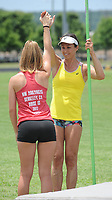 NWA Democrat-Gazette/ANDY SHUPE<br /> April Steiner Bennett (right), a former Arkansas and Olympic pole vaulter, works with camper Madison Sanders, 15, of Marianna, Friday, June 16, 2017, during instruction for pole vaulters at Ramay Junior High School in Fayetteville. Steiner Bennett and Stacy Dragila, a former Olympic pole vaulter and 2000 Olympic gold medalist, were on hand for two days of intensive instruction for vaulters from elementary to high school.