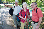 Group of older people looking at a park location map and planning their walk, Nottingham. MR
