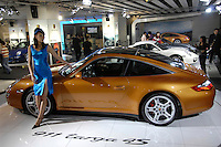 A model poses with a Porsche 911 Targa at the 2006 International Automotive Exhibition in Beijing..25 Nov 2006