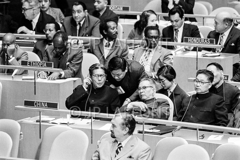 16 Nov 1971 --- The first sitting at the UN of the People's Republic of China (PRC) delegation attracting a great deal of attention in the United Nations General Assembly. The PRC delegation was headed by Chiao Kuan Hua, Vice Minister of Foreign Affairs (center left) and First UN Ambassador of the People's Republic of China, Huang Hua (center right). Behind them is President Mao's niece, Ms. Wang Hai Yong. On October 25, 1971 the United Nations General Assembly admitted the People's Republic of China as a UN and permanent member of the Security Council, expelling the Republic of China (or nationalist Taiwan). --- Image by © JP Laffont